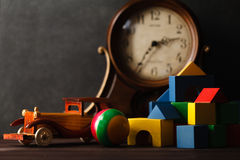 Wooden toy car on table with building blocks Royalty Free Stock Photography