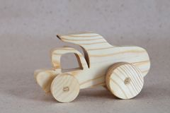 Wooden toy car truck, dumper. Handmade with a pronounced wood structure Stock Photography