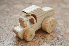 Wooden toy car truck, dumper. Handmade with a pronounced wood structure Royalty Free Stock Image