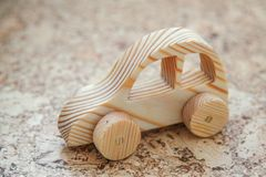 Wooden toy car. Handmade with a pronounced wood structure Royalty Free Stock Photography