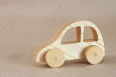Wooden toy car. Handmade with a pronounced wood structure Stock Images