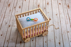 Wooden toy cart with baby rattle Stock Photos