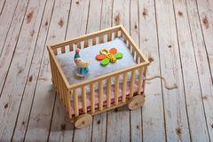 Wooden toy cart with baby rattles Royalty Free Stock Photo