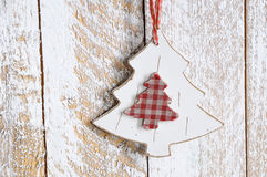 Wooden toy - Christmas tree. On wooden background Stock Photo