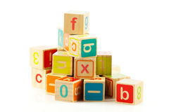Wooden toy cubes with letters. Stock Photography