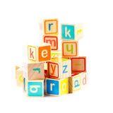 Wooden toy cubes with letters. Stock Image