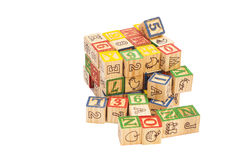Wooden toy cubes with letters. Wooden alphabet blocks Royalty Free Stock Photo