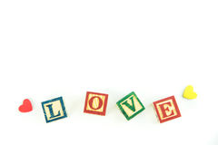Wooden toy cubes are used to create the word love,Love concept o. R valentine day Stock Photography
