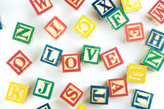 Wooden toy cubes are used to create the word love,Love concept o. R valentine day Royalty Free Stock Images