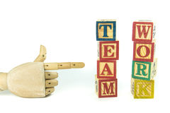 Wooden toy cubes are used to create the word team work. Royalty Free Stock Photos