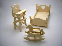 Wooden toy furniture:bedroom. Wooden building blocks toy:furniture of children`s bedroom,horizontal closeup royalty free stock images