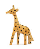 Wooden toy giraffe. Simple toy giraffe carved in wood. Isolated on white with natural shadows Stock Photography