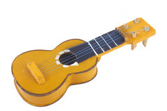 Wooden toy guitar Royalty Free Stock Photo