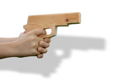 Wooden toy gun in child's hand. Isolated with shadow Stock Images