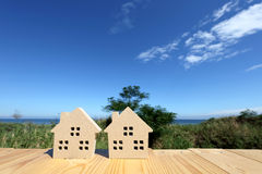 Wooden toy house. Against clear blue sky background Stock Photos