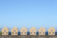 Wooden toy house. Against clear blue sky background Royalty Free Stock Image