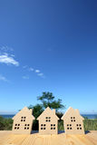 Wooden toy house. Against clear blue sky background Royalty Free Stock Photography