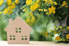 Wooden toy house with blossom tree Royalty Free Stock Photography