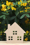 Wooden toy house with blossom tree Stock Photos