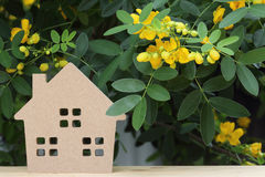 Wooden toy house with blossom tree Stock Images