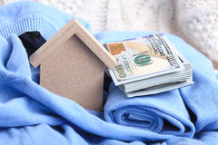 Wooden toy house with dollars cash money Royalty Free Stock Photo