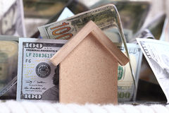 Wooden toy house with dollars cash money Royalty Free Stock Photos