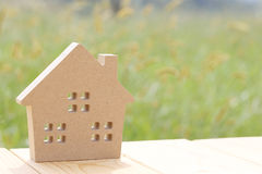 Wooden toy house. On green grass background Stock Photography