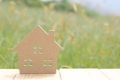 Wooden toy house. On green grass background Stock Image