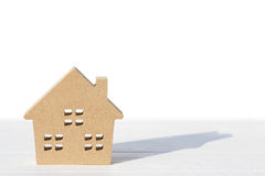 Wooden toy house on table. On white background Royalty Free Stock Photography
