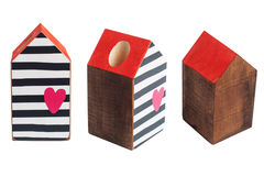 Wooden toy house wit red roof stock photography