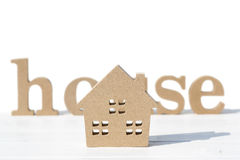 Wooden toy house and word on table. On white background Royalty Free Stock Photo