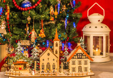 Wooden toy houses on a background of the Christmas tree. Royalty Free Stock Image