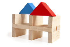 Wooden toy houses isolated on white Royalty Free Stock Images
