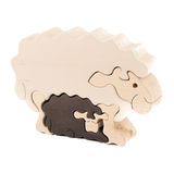 Wooden toy lamb. Wooden creative lamb puzzle toy on white stock images