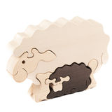 Wooden toy lamb. Wooden creative lamb puzzle toy on white royalty free stock photos