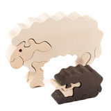 Wooden toy lamb. Wooden creative lamb puzzle toy on white royalty free stock photo