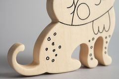 The wooden toy of lynx for kids front view isolated light background at the studio. Smiling toy. The wooden toy of lynx for kids front view isolated light Royalty Free Stock Images