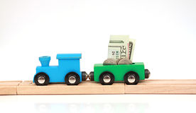 Wooden Toy Money Train. Toy wooden train isolated on white background with money Stock Images