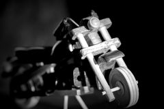 Wooden toy motorcycle on a dark background Royalty Free Stock Images