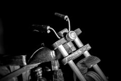 Wooden toy motorcycle on a dark background Royalty Free Stock Photos