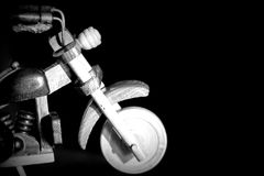Wooden toy motorcycle on a dark background Royalty Free Stock Image