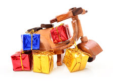 Wooden toy motorcycle and gifts Royalty Free Stock Photography