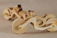 Wooden toy motorcycle royalty free stock photos