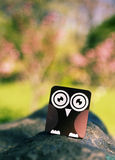 Owl. Wooden owl toy on a stone Stock Images