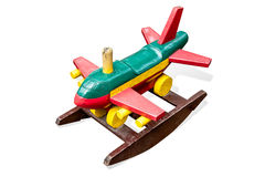 Wooden toy passenger jet plane Royalty Free Stock Photo