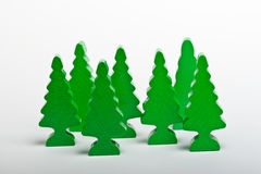 Wooden toy pine trees. Wooden toy pine forest isolated on white background Royalty Free Stock Images
