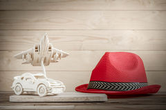 Wooden toy plane hand carved model and a car on wood background Stock Image