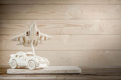 Wooden toy plane hand carved model and a car on wood background Stock Photo