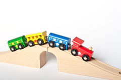 Wooden toy railway. Wooden toy train on a bridge isolated on white background Stock Image