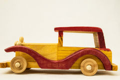 Wooden Toy Red and Yellow Car Stock Images